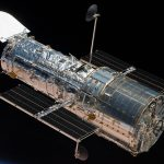 Hubble Space Telescope in Orbit in Space with Stars