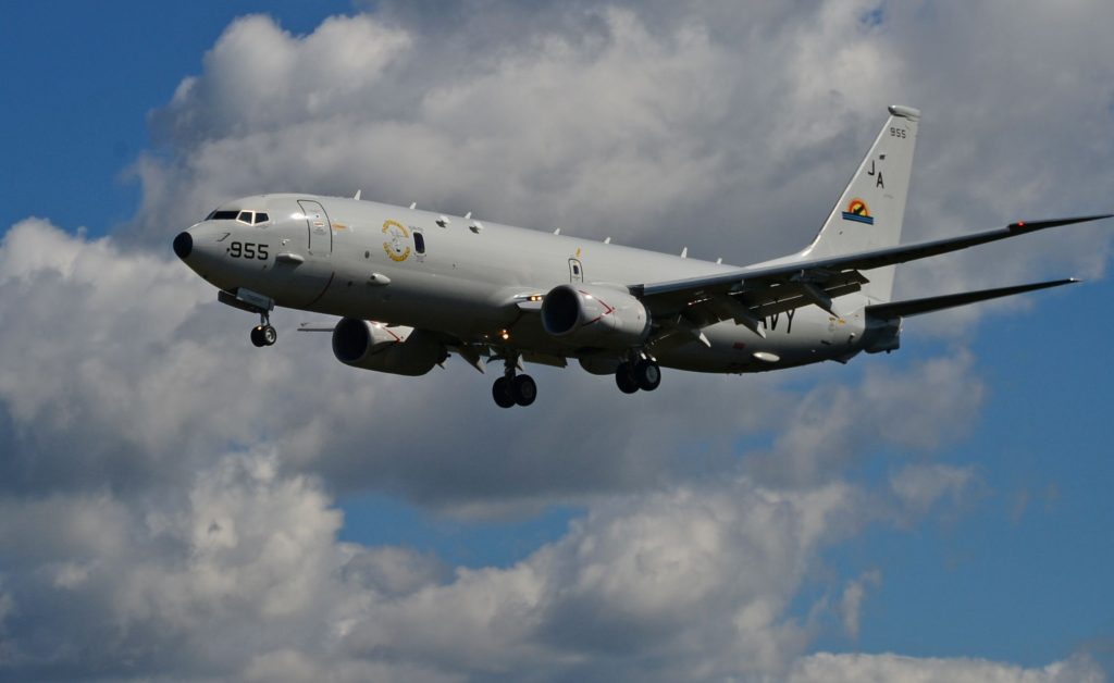 maritime patrol aircraft in front of clouds