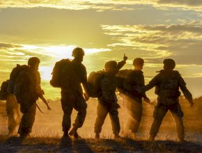 army soldiers in front of a sunset