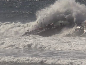 An amphibious vehicle crashes into a wave in high ocean surf